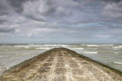 A breakwater at the coastline Stock Images