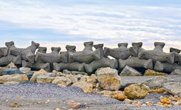Breakwater. With concrete blocks for protection of coast Stock Photography