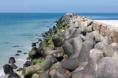 Breakwater with concrete tetrapods at German island Dune near He. Breakwater with concrete tetrapods at Dune island near Helgoland, Germany stock image