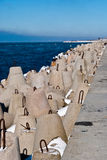 Breakwater covered by ice Stock Images