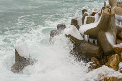 Breakwater covered by ice Stock Image