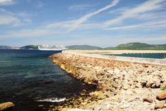 The Breakwater and Cruise Ship Stock Photo