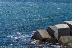 Breakwater cube Stock Images