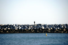 Breakwater Dana Point. A breakwater with piled rocks in the harbor of Dana Point Stock Photography