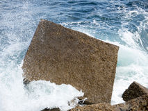 Breakwater. Detail of a cement block, acting as a breakwater Stock Images