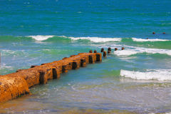 Breakwater of the emerald sea waves Royalty Free Stock Photos