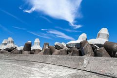 Breakwater with empty road and concrete blocks royalty free stock image