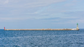 Breakwater at the entrance to the harbor Stock Image