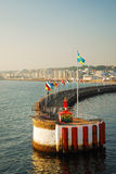 Breakwater with flags in the Kattegat strait Stock Images