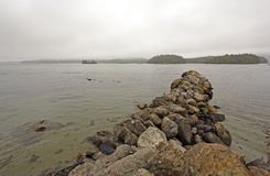 Breakwater and Fog on a Coastal Harbor Royalty Free Stock Photos