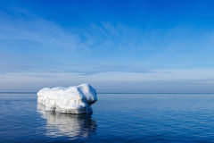 The breakwater in the form of an iceberg in a Sunny winter day. Stock Photo