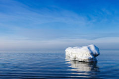 The breakwater in the form of an iceberg in a Sunny winter day. Royalty Free Stock Photo