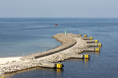 Breakwater with the green lighthouse in Kolobrzeg Stock Photo