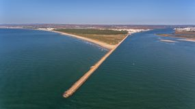 Aerial. Breakwater on the Guadiana River in city Vila Real Santo Antonio. Portugal. Breakwater on the Guadiana River in the city Vila Real Santo Antonio Stock Photography
