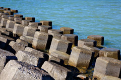 Breakwater. Irregularly arranged with sea Royalty Free Stock Photos