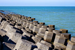 Breakwater. Irregularly arranged with sea Royalty Free Stock Photo