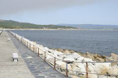 Breakwater in San Vicente. Breakwater at the beach in San Vicente , Galicia, Spain royalty free stock images