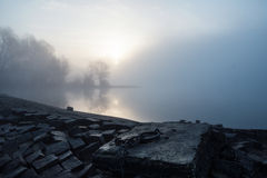 Breakwater with landing Place in the morning Fog Stock Photography