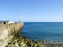 Breakwater Laxey Isle of Man. Breakwater and Lighthouse Laxey Isle of Man Stock Images