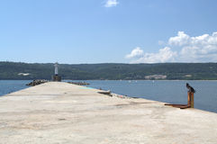 Breakwater and lighthouse Royalty Free Stock Photos
