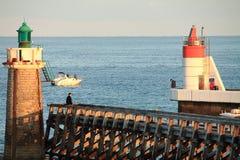 Breakwater with lighthouses in sunrise on atlantic ocean Stock Images