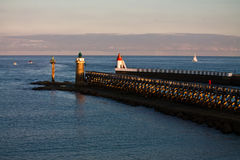 Breakwater with lighthouses in sunrise on atlantic ocean Stock Photo