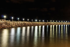 Breakwater ,  Lights on the water at night in the marina. Ashkelon. Israel Royalty Free Stock Photo