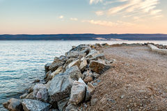 Breakwater on Makarska Riviera at Sunset Royalty Free Stock Photos