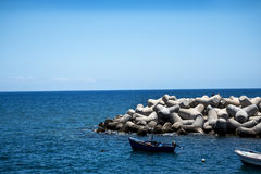 Breakwater near the fort of Sao Tiago in Funchal Madeira Royalty Free Stock Photo