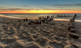 Breakwater in Niechorze during sunset. Beautiful beach in Poland Royalty Free Stock Photography