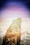 The breakwater in the ocean. Stock Photo
