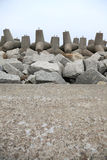 Breakwater. Outdoor - concrete tetrapods on the beach near a port under construction Stock Images