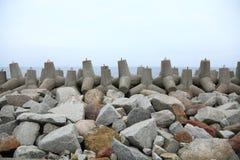 Breakwater. Outdoor - concrete tetrapods on the beach near a port under construction Stock Photo