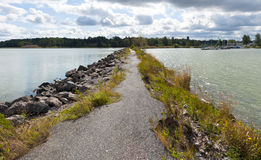 Breakwater, path and sea Stock Photography
