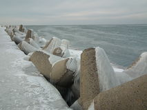 Breakwater, pier covered with snow. Baltic coast, Latvia Stock Image