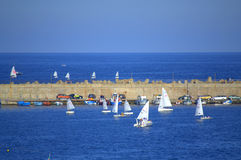Breakwater and racing boats Stock Photo