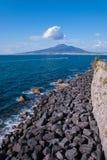 Breakwater on the road Sorrento peninsula. Background volcano Vesuvius, Italy Stock Image