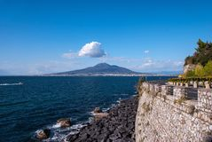 Breakwater on the road Sorrento peninsula. Background volcano Vesuvius, Italy Stock Images