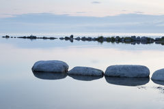 Breakwater Rocks in Calm Sea Stock Image