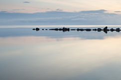 Breakwater Rocks in Calm Sea Royalty Free Stock Photo