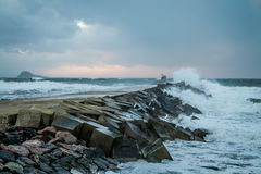 Breakwater. The sea lashes the breakwater until almost knocking it down Royalty Free Stock Photos