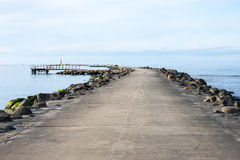 Breakwater in the sea with lighthouse on it Stock Photography