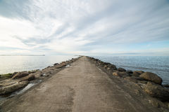 Breakwater in the sea with lighthouse on it Stock Photo