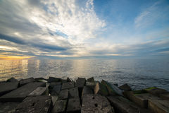 Breakwater in the sea with lighthouse on it Stock Photos