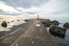 Breakwater in the sea with lighthouse on it Royalty Free Stock Photography