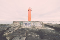 Breakwater in the sea with lighthouse on it Stock Images
