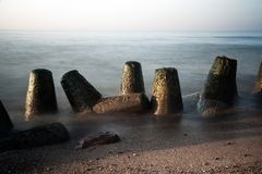 Breakwater in sea long exposure Royalty Free Stock Image
