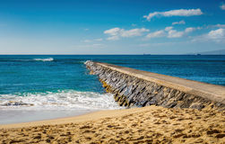 Breakwater, sky, sea and beach Stock Photography