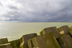 Breakwater stones at the North Sea coastline in Ostend, Belgium Stock Photo