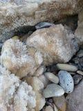 Breakwater stones with salt crystals. Salt water formed into crystals ashore of Sagunto Stock Image